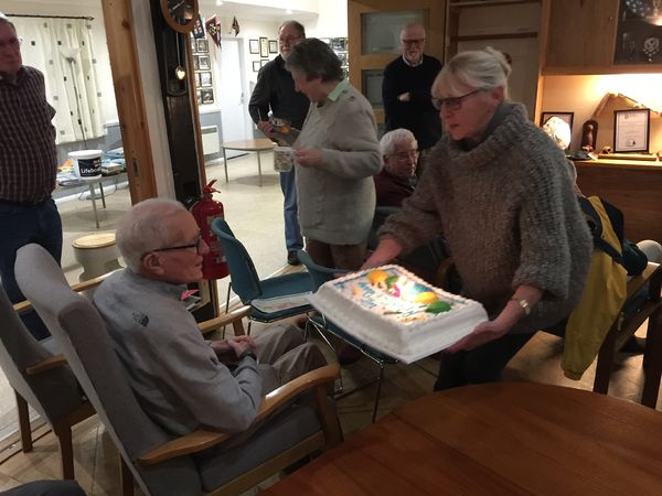 Jim prepares to blow out his 90 candles.JPG